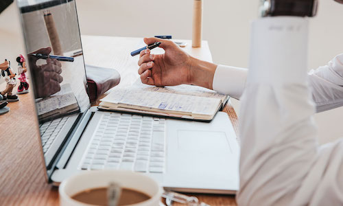 Recruiter with laptop at desk