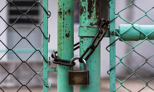 Padlock on chainlink fence
